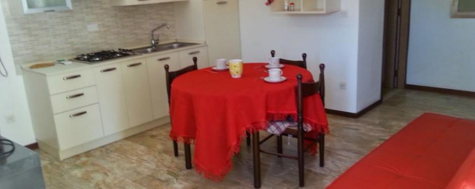 Salotto e cucina del trilocale piccolo